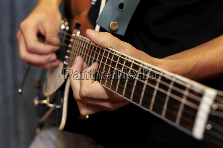 electric guitar close up with fingers
