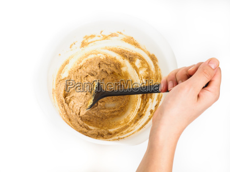 person stirring a bake mix
