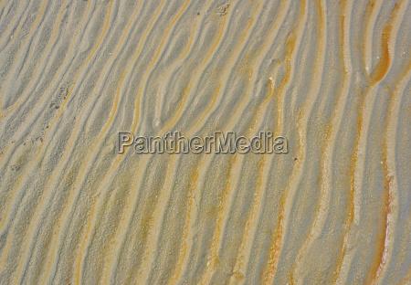 beach wet sand ripple pattern background