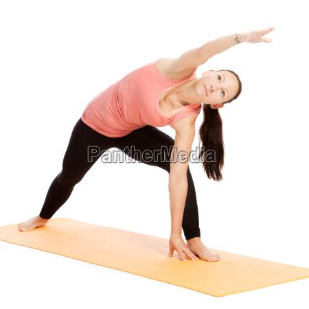 yoga exercise on the mat utthita