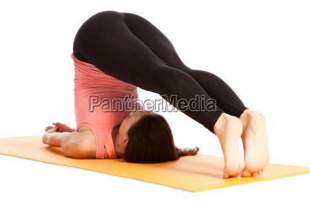 yoga exercise on the mat halasana