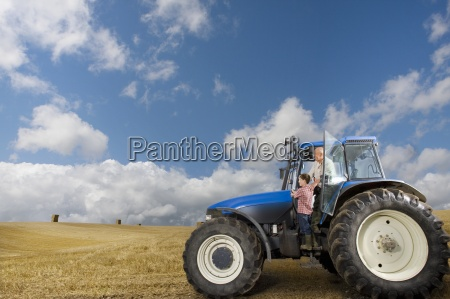 farmer and grandson leaning out of