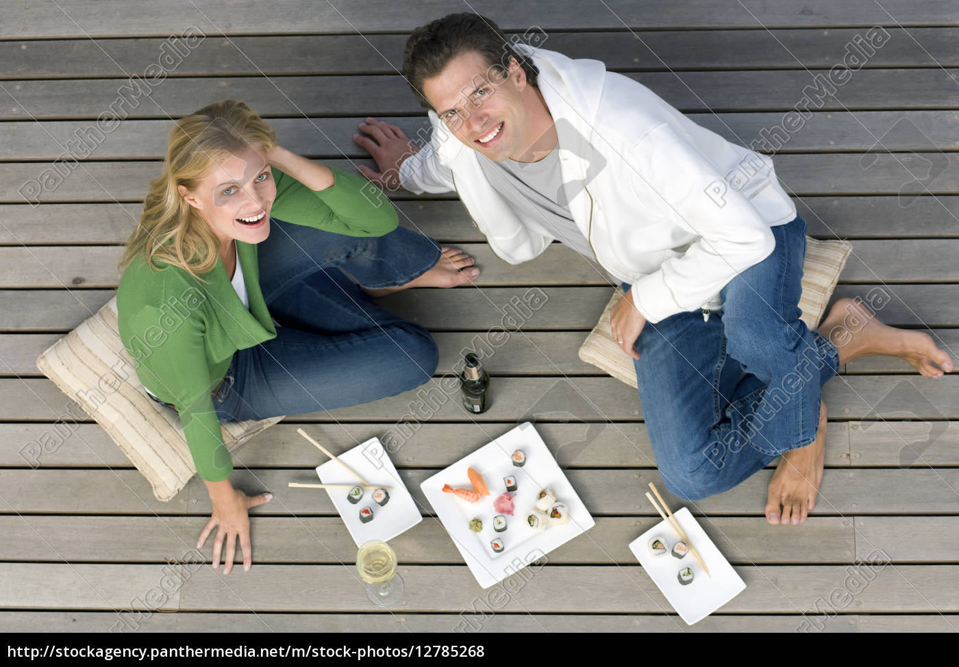 young, couple, with, sushi, and, drinks - 12785268