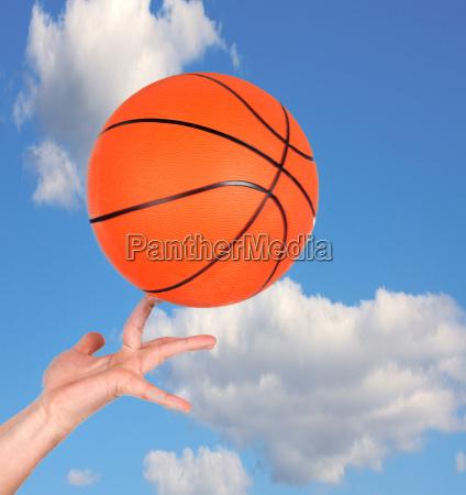 hand holding a basketball
