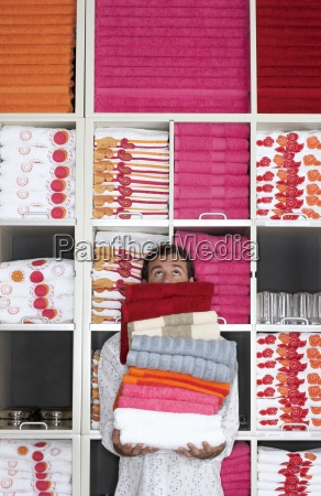 man shopping in department store holding