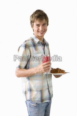 young man holding plate of food