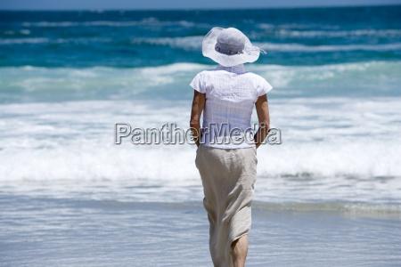 woman in sun hat walking in