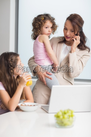 well dressed mother with daughters and