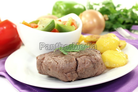 ostrich steaks with baked potatoes and
