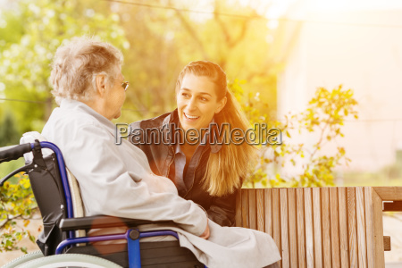 young woman visiting grandmother in nursing