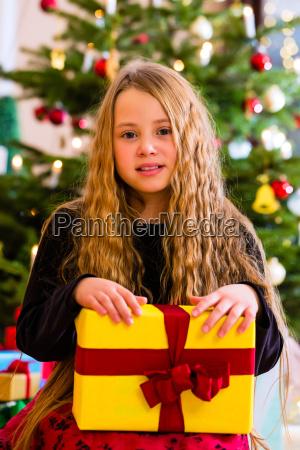 girl with christmas gift on christmas