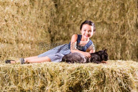 bavarian girl playing with cat on