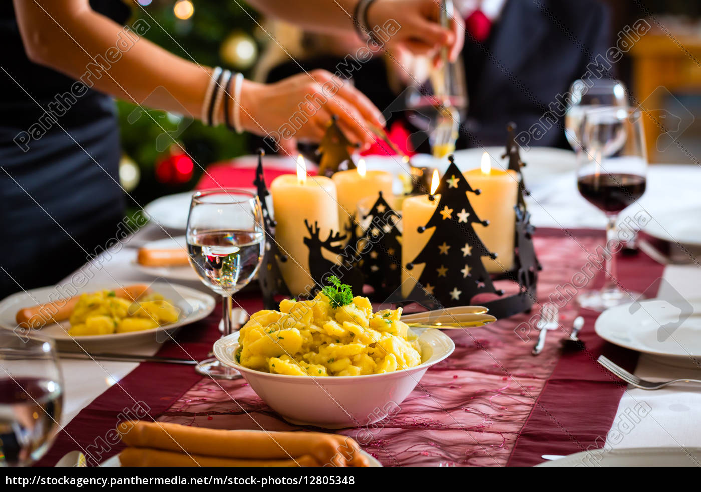 Royalty free photo 12805348 - traditional german christmas dinner sausages and potato salad
