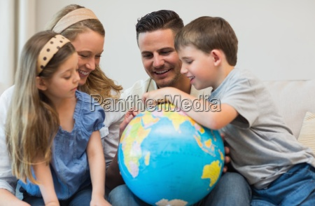 family searching places on globe