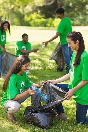 team of volunteers picking up litter