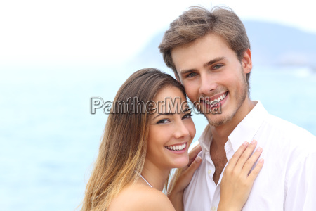 happy couple with a white smile