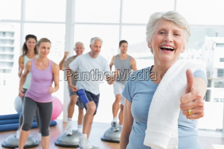 senior woman gesturing thumbs up with