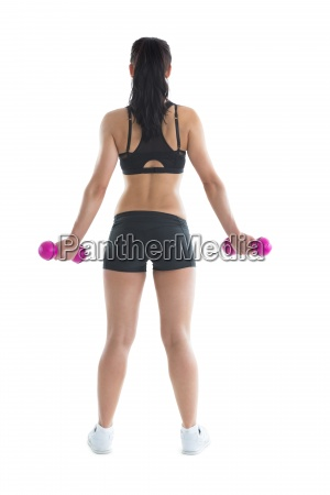 rear view of slim ponytailed woman
