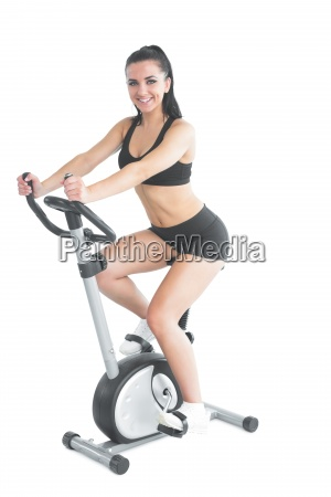 cheerful ponytailed sporty woman training on