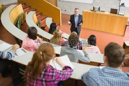 elegant teacher with students at the