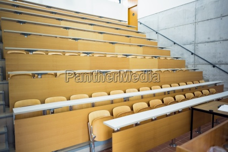 empty seats with tables in a
