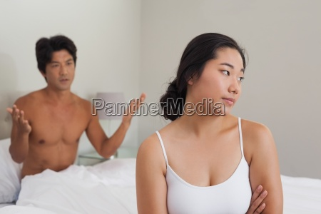 couple having an argument in bed