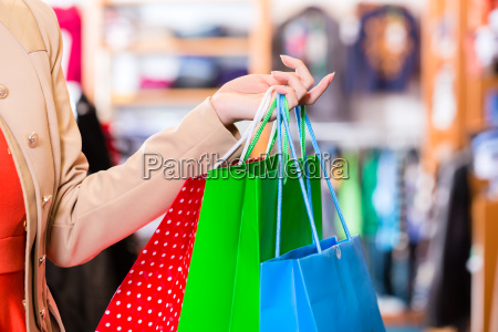 woman with shopping bags in store