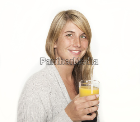 young woman with glass of juice