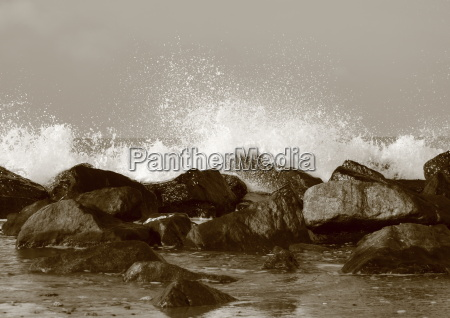 silent water behind large rocks at