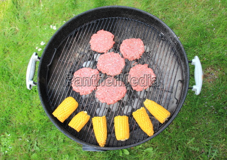 barbeque grill with beef burger and