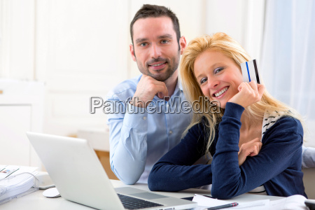 young attractive couple shopping online