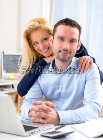 portrait of young attractive couple using