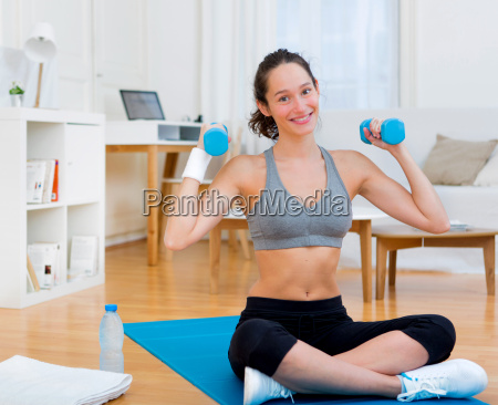 young attractive girl doing exercise at