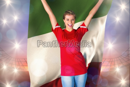 cheering football fan in red holding