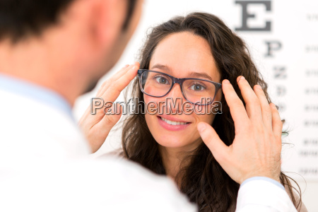 young attractive woman trying glasses w