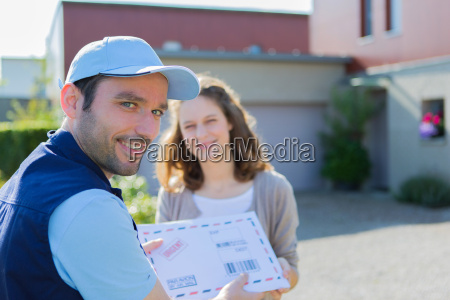 delivery man handing over a registered