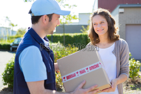 delivery man handing over a parcel
