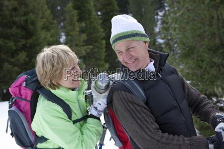 senior woman in snowy woods placing