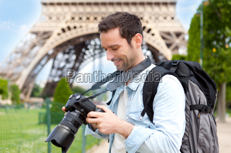 young attractive tourist taking pictures in