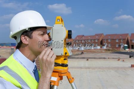 close up profile of surveyor looking