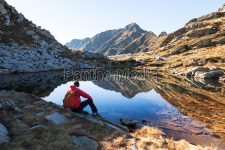 male hiker takes a rest sitting