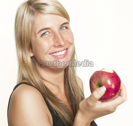 laughing woman with apple