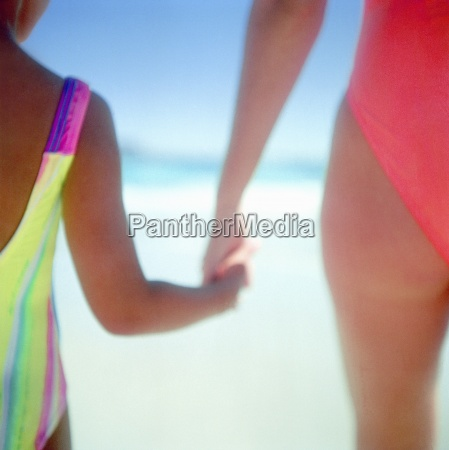 mother and daughter in bathing suits