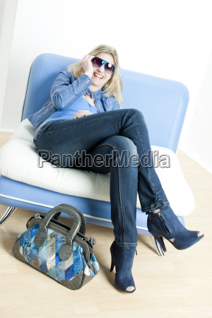 woman wearing blue clothes lying on