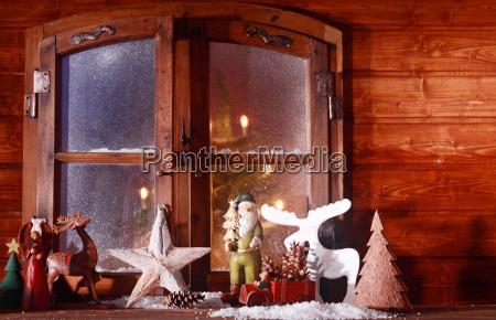 festive christmas log cabin window