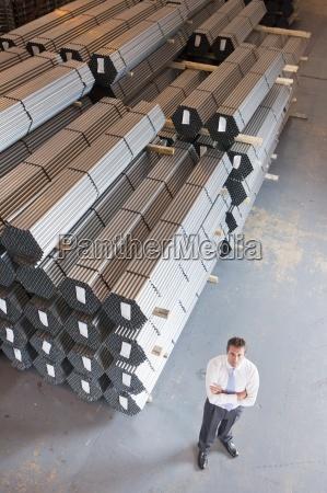 portrait of confident businessman near steel