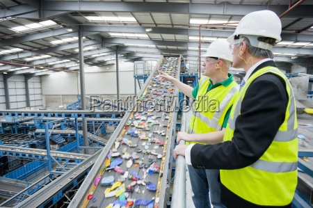 businessman and worker talking next to