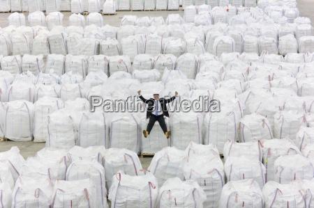 portrait of enthusiastic businessman sitting on