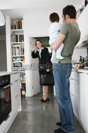 a mother leaving for work waving