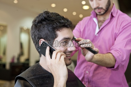 a male client talking on the